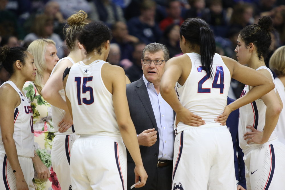 All four of UConn's All-American recipients (from left to right: Samuelson, Williams, Collier, and Nurse) surround Geno Auriemma during a timeout during the Huskies' Elite 8 win over UCLA. (Jackson Haigis/The Daily Campus)
