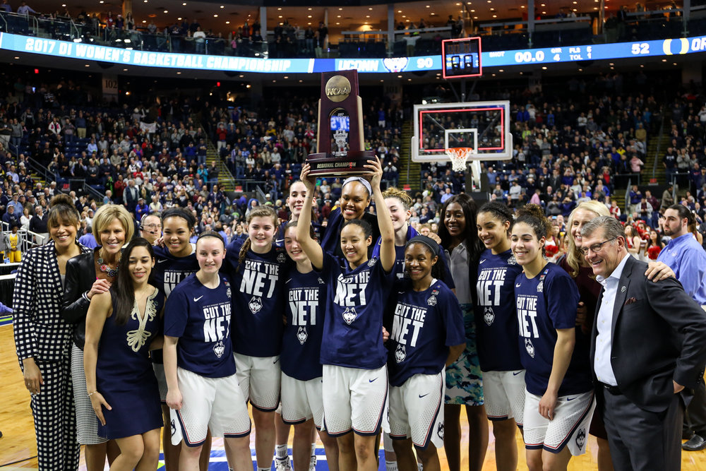 The UConn women's basketball team poses with the Bridgeport Region trophy after defeating Oregon 90-52 on Monday night at Webster Bank Arena in Bridgeport. The Huskies advanced to their 10th straight Final Four with the win. (Jackson Haigis/The Daily Campus)