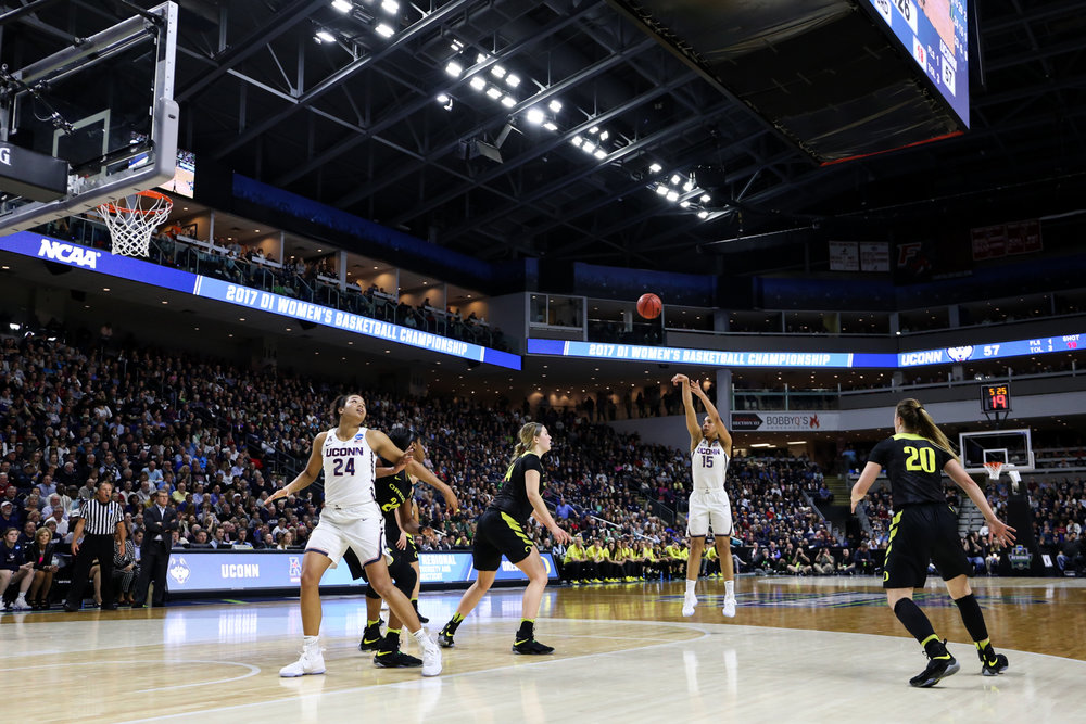 UConn junior Gabby Williams (right) launches a jump shot in the second half. Williams, along with teammate Napheesa Collier (left), carried the Huskies to a 38-point win.