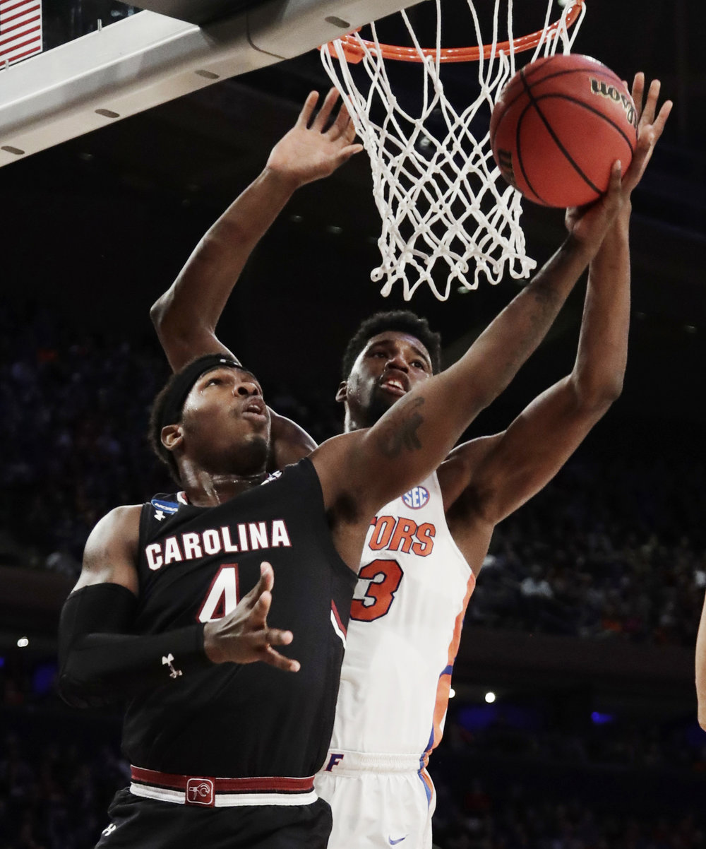 South Carolina guard Rakym Felder (4) puts up a shot against Florida forward Kevarrius Hayes (13) during the first half of the East Regional championship game of the NCAA men's college basketball tournament, Sunday, March 26, 2017, in New York. (Frank Franklin II/AP)