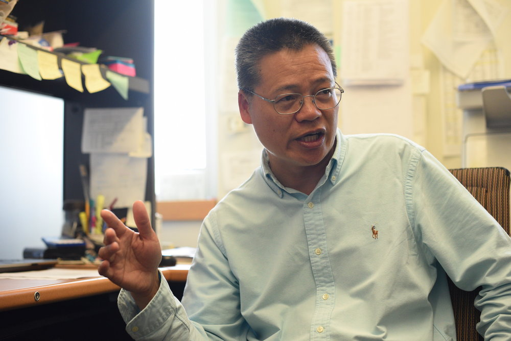 Laijun Lai, Associate Research Professor in the Department of Allied Health Sciences at the University of Connecticut, talks about his latest research about cancer to a Daily Campus writer on March 29th. (Zhelun Lang/The Daily Campus)