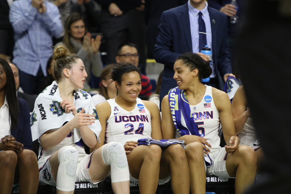 Katie Lou Samuelson, Napheesa Collier and Gabby Williams relax on the bench during the Huskies 90-52 victory over the Oregon Ducks on Monday, March 27, 2017. (Jackson Haigis/The Daily Campus)