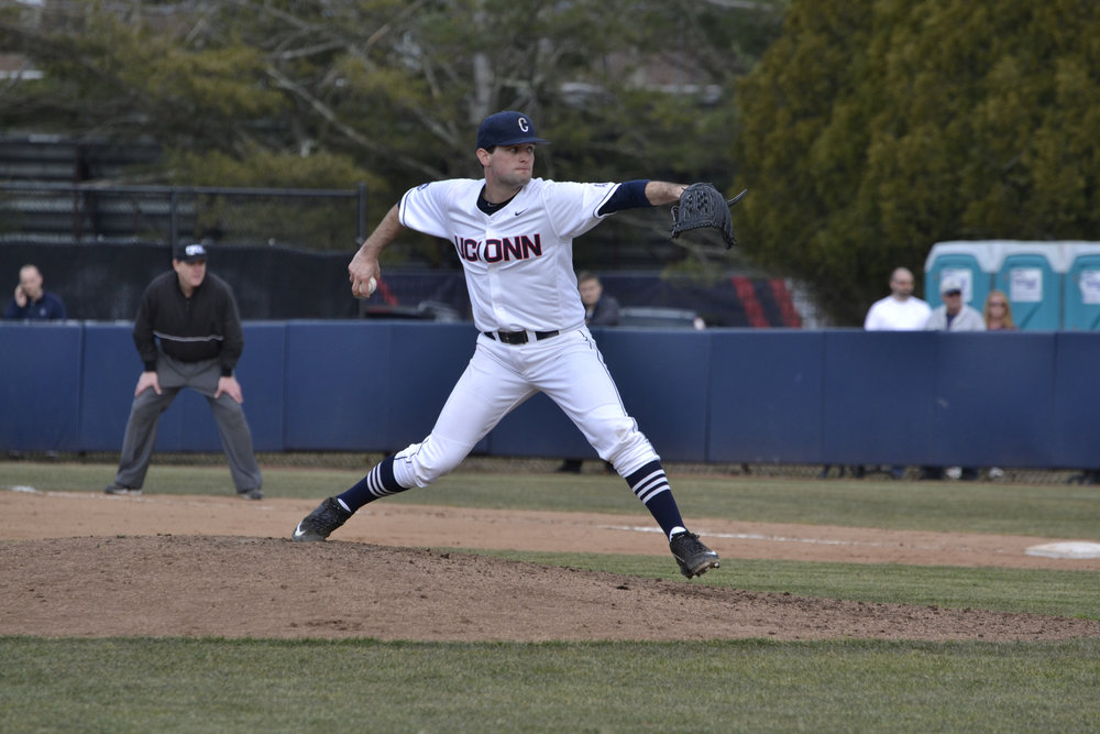 Senior Andrew Zapata throws a pitch in a game against Yale on March 8, 2016. The Huskies defeated Fairfield 6-1 on Wednesday afternoon. (File Photo/The Daily Campus)