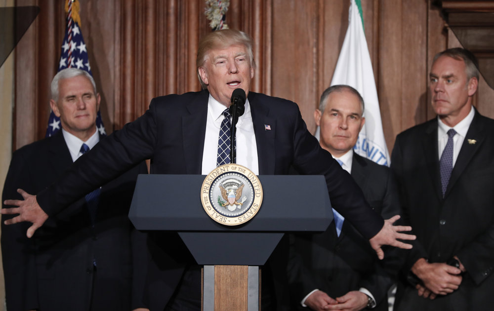 President Donald Trump, accompanied by from left, Vice President Mike Pence, Environmental Protection Agency (EPA) Administrator Scott Pruitt, and Interior Secretary Ryan Zinke, speaks at EPA headquarters in Washington, Tuesday, March 28, 2017, prior to signing an Energy Independence Executive Order. Trump signed an executive order aimed at moving forward on his campaign pledge to unravel former President Barack Obama's plan to curb global warming. (AP/Pablo Martinez Monsivais)