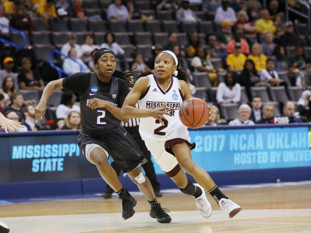 In this Friday, March 24, 2017 photo, Mississippi State guard Morgan William (2) drives past Washington guard Aarion McDonald (2) during a regional semifinal of the NCAA women's college basketball tournament. (AP Photo/Sue Ogrocki)