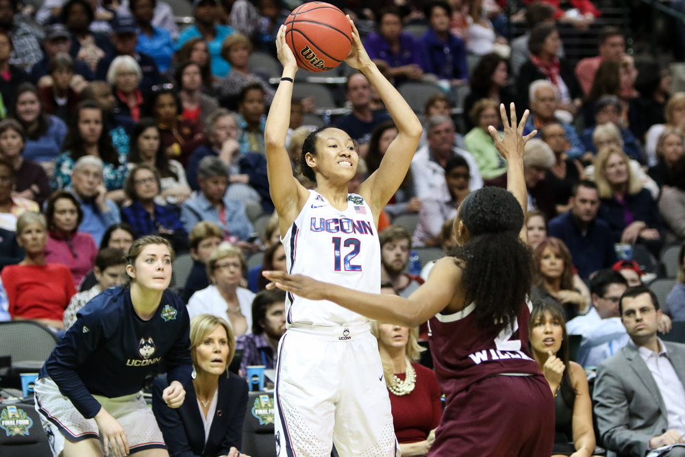UConn guard Saniya Chong looks to pass as teammate Kyla Irwin looks on anxiously. Chong scored 10 points and had 5 assists for the Huskies.