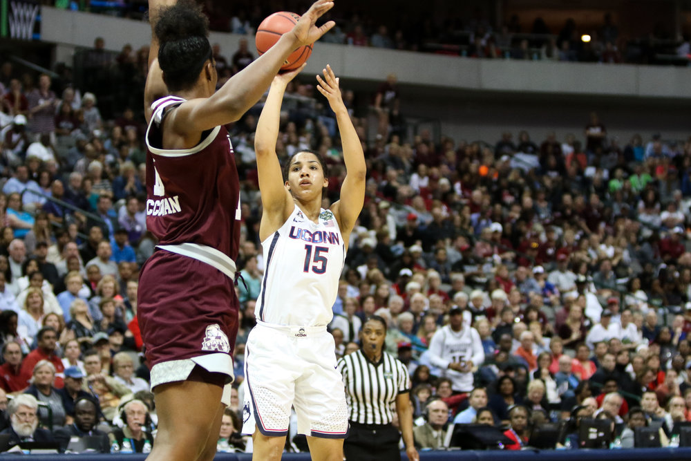UConn forward Gabby Williams launches a jumper over Bulldogs center Teaira McCowan. Williams led the Huskies with 21 points and 8 rebounds.