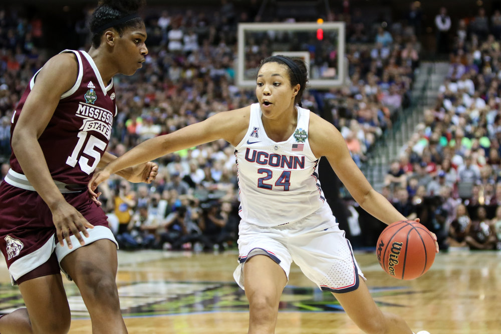 UConn forward Napheesa Collier drives to the basket in the second half. Collier was held to just 11 points by Mississippi State.