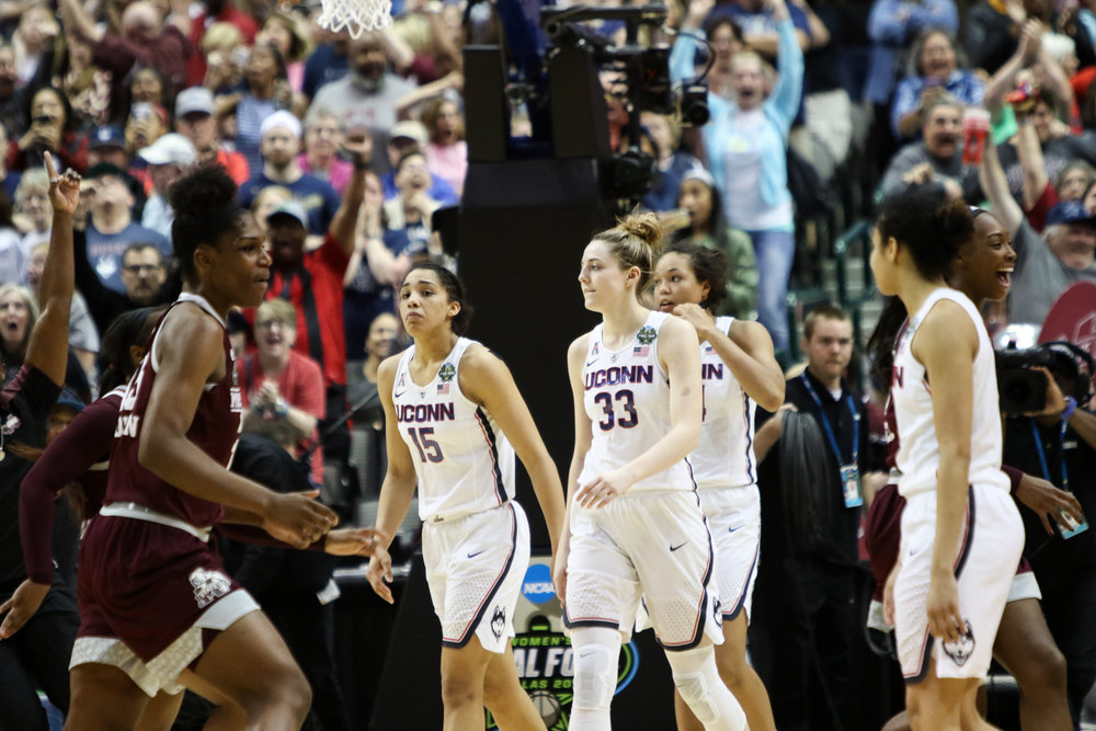 UConn players react to Mississippi State's Morgan William's game-winning jumper. Sophomores Katie Lou Samuelson (second from left) and Napheesa Collier (third from left) had never lost a game in a UConn uniform before Friday night.