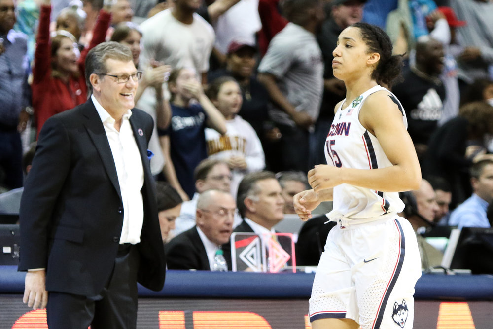 "UConn's Gabby Williams holds back tears after the game while head coach Geno Auriemma cracks a smile. ""I knew this was coming at some point,"" Auriemma remarked in the post-game press conference."