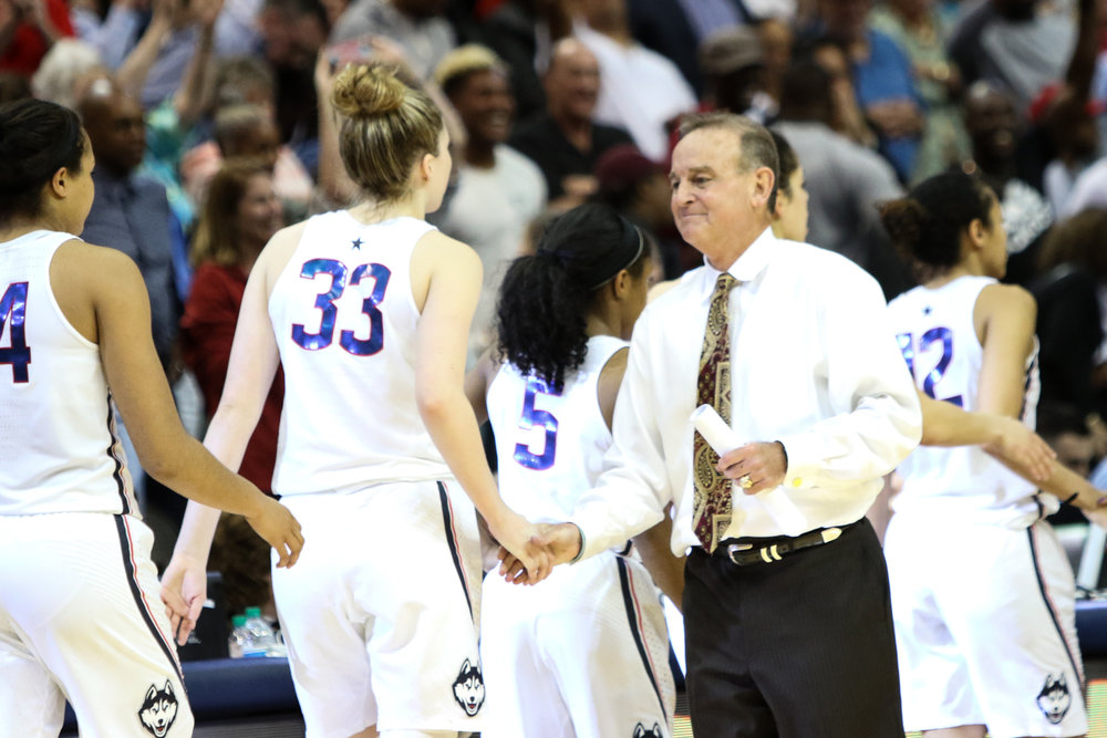 Mississippi State head coach Vic Schaefer shakes hands with UConn players following the Bulldogs' win.