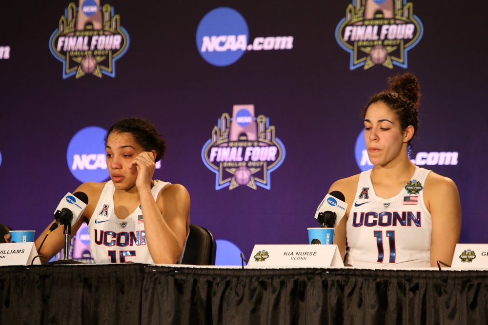 UConn juniors Gabby Williams (left) and Kia Nurse hold back tears during the post-game press conference.