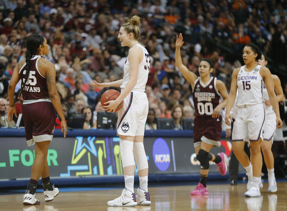 Connecticut guard/forward Katie Lou Samuelson (33) reacts to a call that didn't go her way against Mississippi State forward Victoria Vivians (35) in the first half of an NCAA college basketball game in the semifinals of the women's Final Four in Dallas on Friday, March 31, 2017. (Tom Fox/The Dallas Morning News via AP)