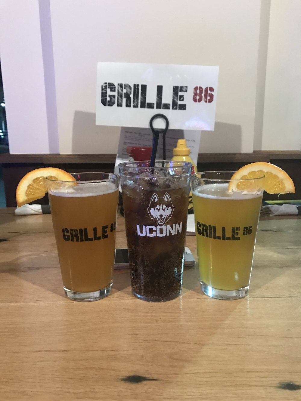 Shock Top Belgian White is on draft along with 23 other brews at the freshly-opened Grille 86 in Storrs Center. The sports bar have two sizes of draft beers, a few bottled beer options and free refills on soft drinks. (Francesca Colturi/The Daily Campus)