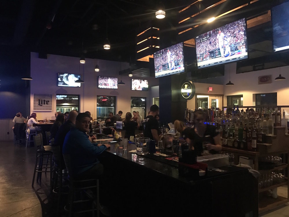 Grille 86 opened in Storrs Center on Sunday, April 3, 2017. The bar is clean and spacious with a large u-shaped bar, two side rooms with ample seating and 31 televisions for every sporting match being broadcast. (Francesca Colturi/The Daily Campus)