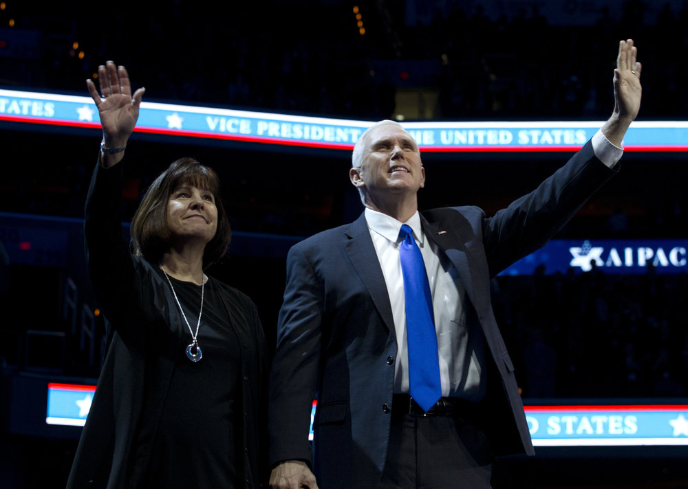 Vice President Mike Pence, right, and his wife Karen wave to the crowd at the 2017 American Israel Public Affairs Committee (AIPAC) policy conference in Washington, Sunday, March 26, 2017. (AP Photo/Jose Luis Magana)