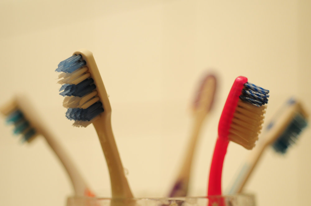 Most dental practitioners suggest that you replace your tooth brush after about 3-5 months of regular use. If everyone followed these guidelines from an early age of using traditional toothbrushes, on average, by the time you are 21, you would have deposited roughly 80 toothbrushes per person into dead end trash cycles. (Steven Lilley/Flickr Creative Commons)