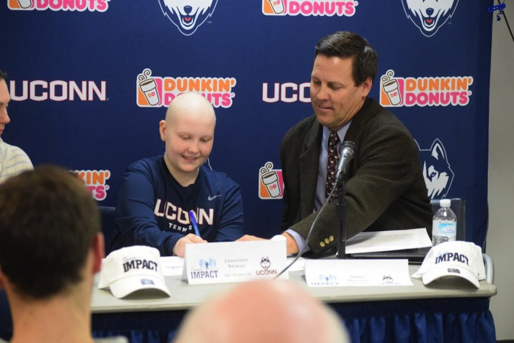 Ten-year old Genevieve Neiman, who has leukemia, joined the women's tennis program with her signing of a Husky Letter of Intent. (Photo courtesy of Athletic Communications)