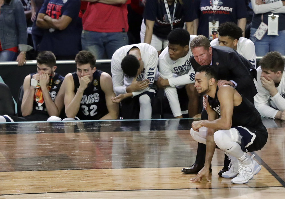 Gonzaga head coach Mark Few talks to Nigel Williams-Goss after the finals of the Final Four NCAA college basketball tournament against North Carolina, Monday, April 3, 2017, in Glendale, Ariz. North Carolina won 71-65. (AP Photo/Matt York)