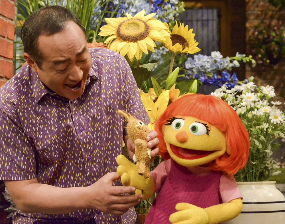"This image released by Sesame Workshop shows Julia, a new autistic muppet character debuting on the 47th Season of ""Sesame Street,"" on April 10, 2017, on both PBS and HBO. (Zach Hyman/ AP)"