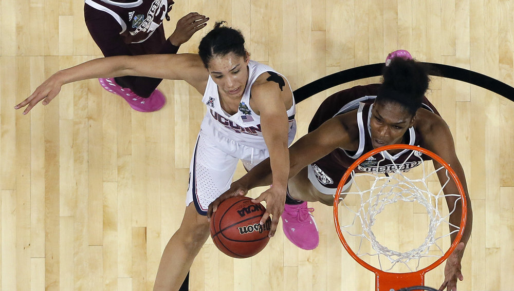 Connecticut guard Gabby Williams, left, is blocked by Mississippi State center Teaira McCowan, right, as she tries to score during the second half of an NCAA college basketball game in the semifinals of the women's Final Four, Friday, March 31, 2017, in Dallas.(Tony Gutierrez/ AP)