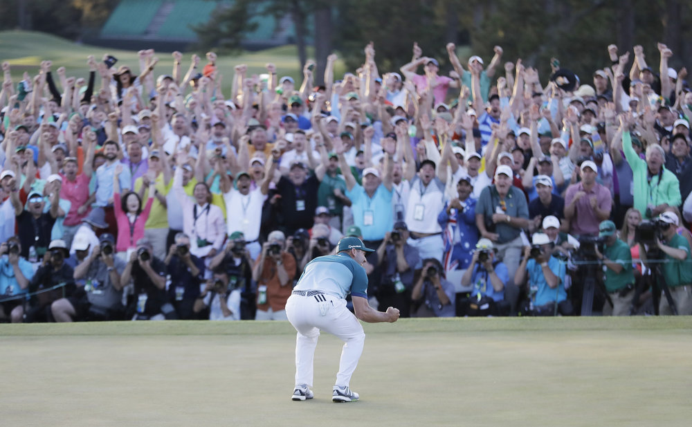 Sergio Garcia, of Spain, reacts after making his birdie putt on the 18th green to win the Masters golf tournament after a playoff Sunday, April 9, 2017, in Augusta, Ga. (AP Photo/David Goldman)