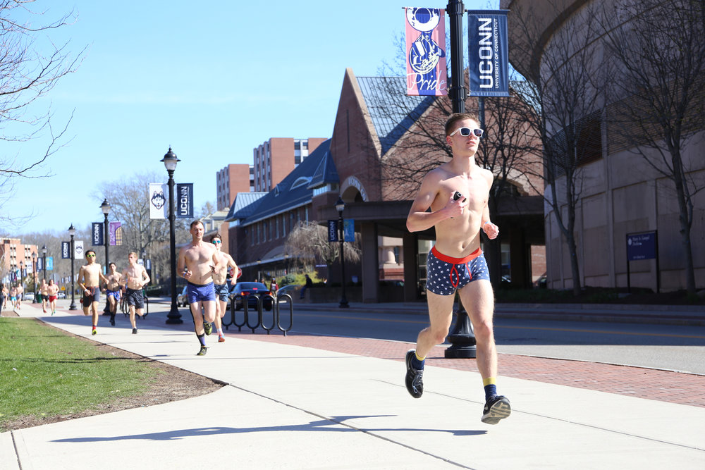Students cross the finish line in UConn's annual underwear mile on April 17, 2016 at the top of Fairfield Way. (Jackson Haigis/The Daily Campus)
