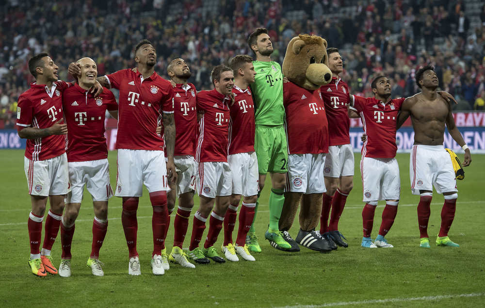 Bayern's players celebrate after the German Bundesliga soccer match between FC Bayern Munich and Borussia Dortmund in Munich, Germany, Saturday, April 8, 2017. Munich defeated Dortmund by 4-1. (Sven Hoppe/dpa via AP)
