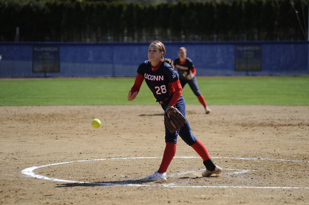 Senior Kayla Doty pitching in UConn's game against Bryant University on March 29.  (Jason Jiang/The Daily Campus)