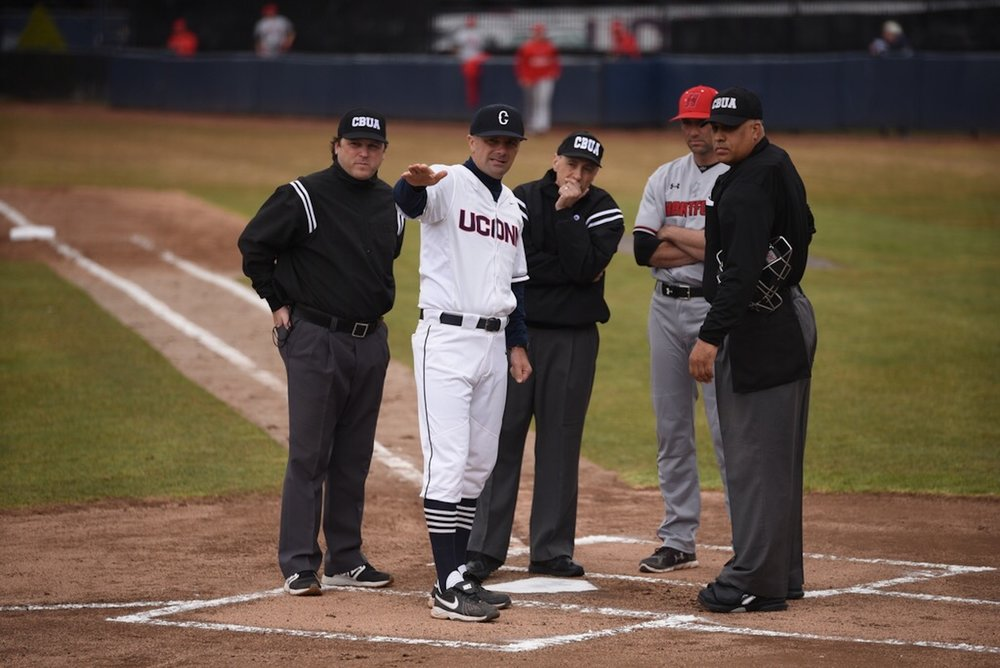 UConn manager Jim Penders converses with the umpires during the Huskies' gam against Hartford on April 5, 2017. (Zhleun Lang/The Daily Campus)