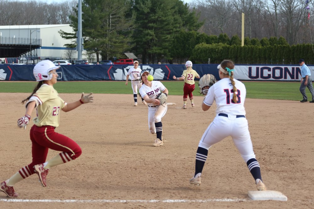 Carli Cutler goes in for a catch to strike out Boston College's batter in Tuesday's game at UConn. The Huskies won with a score of 3-2. (Tyler Benton/The Daily Campus)