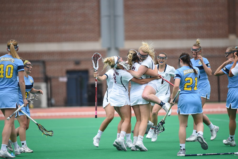 The Women's Lacrosse team defeated Marquette 17-14. Players celebrate after their success.  (Charlotte Lao/ The Daily Campus)