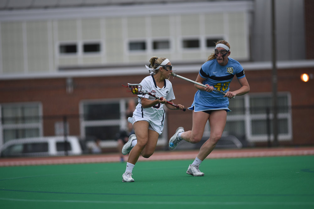 The Women's Lacrosse team defeated Marquette 17-14. Jacqueline Jordan and Grace Nolan both contributed 7 points. Their next match is at Cincinnati on April 15. (Charlotte Lao/ The Daily Campus)