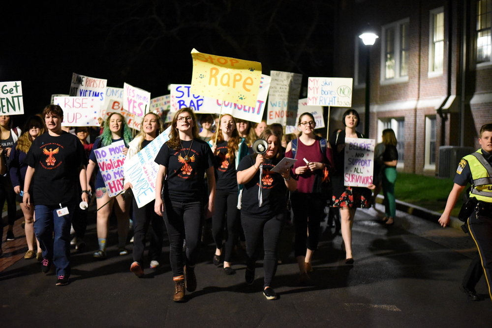 Students marched around UConn's Storrs campus Wednesday night as part of Take Back the Night, a feminist empowerment event organized by the Violence Against Women Prevention Program as part of Sexual Assault Awareness Month. (Charlotte Lao/The Daily Campus)