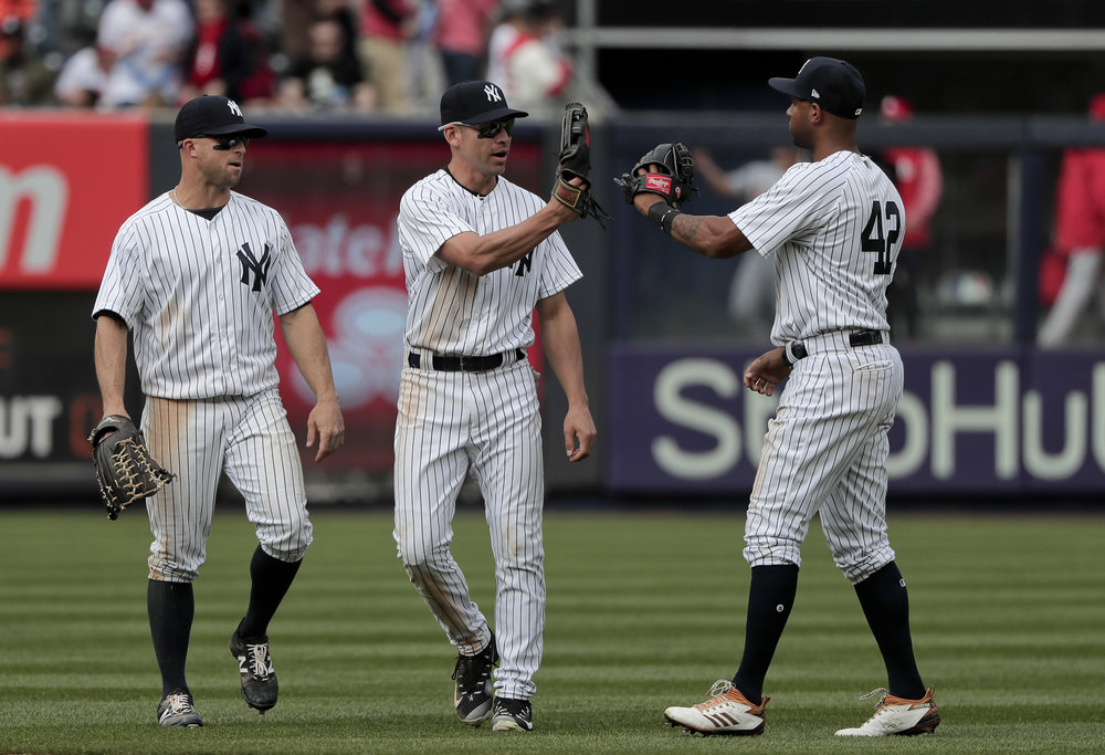 From left to right, New York Yankees Brett Gardner, Jacoby Ellsbury and Aaron Hicks celebrate after they defeated the St. Louis Cardinals in a baseball game, Saturday, April 15, 2017, in New York. (AP Photo/Julie Jacobson)
