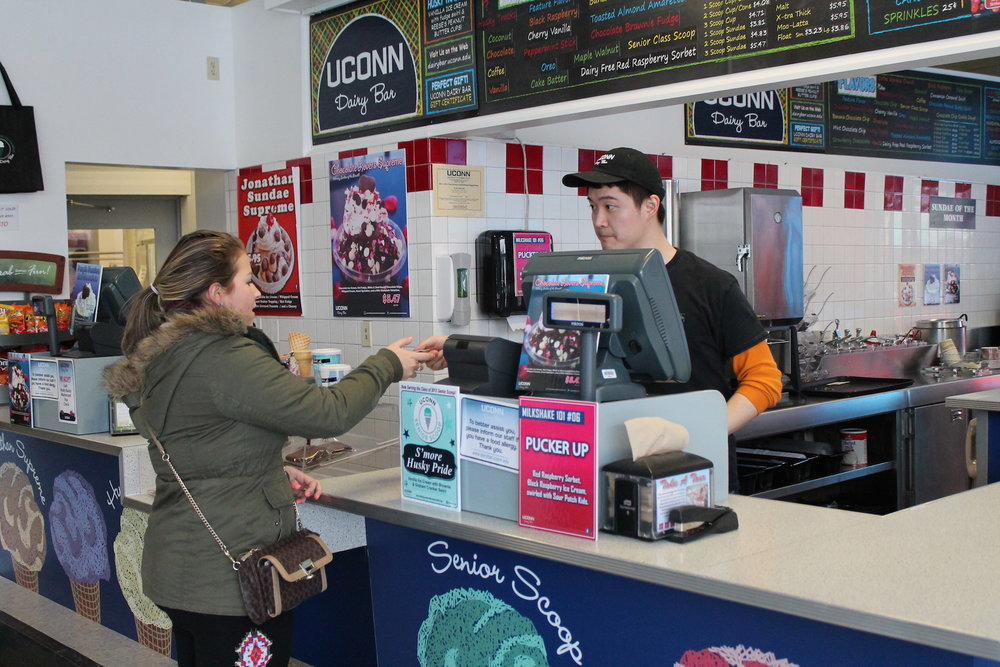 Shin Soyoma, a 6th semester Nutritional Sciences major, serves a customer. No sad and terrible grocery store popsicle can compare to the fabulous creamery concoctions dreamed up by the UConn Dairy Bar. (Kelley Huber/The Daily Campus)