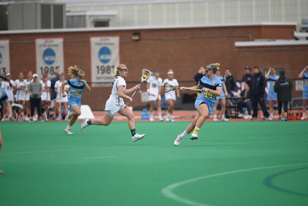 The women's lacrosse team took down Marquette 17-14 in a game earlier in the week before the Cincinnati match. (Charlotte Lao/The Daily Campus)