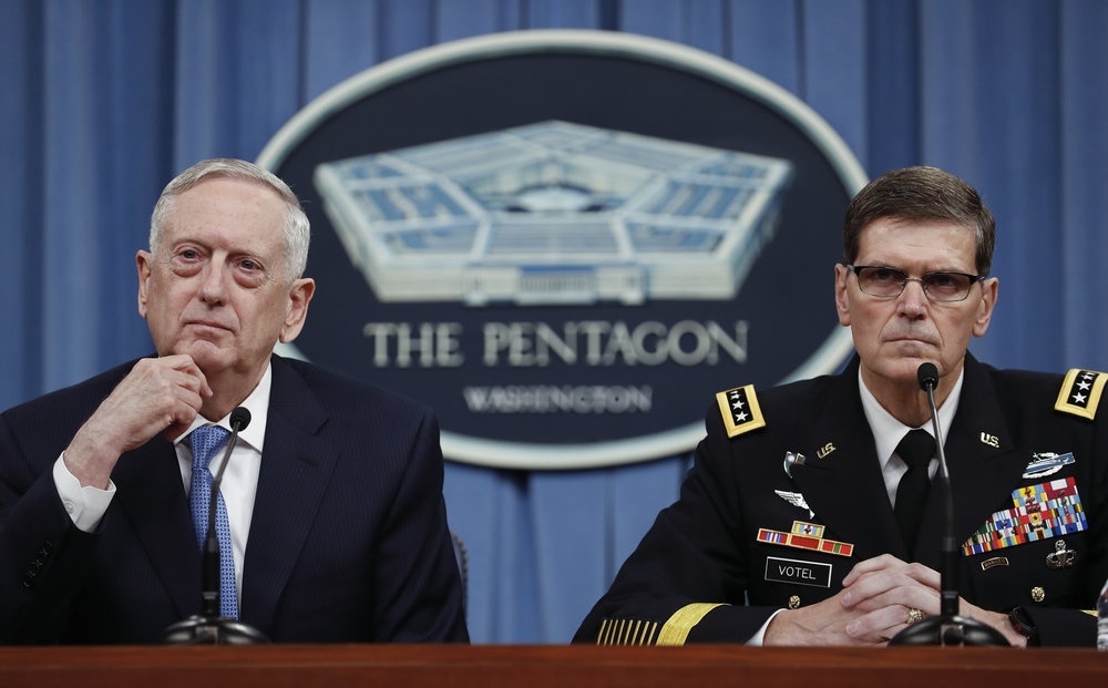 Defense Secretary Jim Mattis, left, and Gen. Joseph Votel, listen to questions during a news conference at the Pentagon, Tuesday, April 11, 2017. Mattis said the campaign against the Islamic State group is still the main focus of the U.S. in Syria and remains on track. (AP Photo/Carolyn Kaster)
