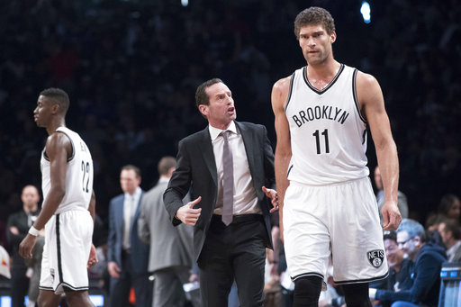 Brooklyn Nets head coach Kenny Atkinson gives center Brook Lopez (11) instruction during the second half of an NBA basketball game against the Chicago Bulls, Saturday, April 8, 2017, in New York. The Nets won 107-107. (AP Photo/Mary Altaffer)
