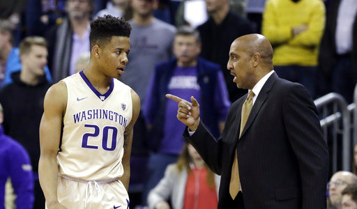 In this Feb. 4, 2017, file photo, Washington coach Lorenzo Romar, right, talks with Markelle Fultz during the team's NCAA college basketball game against UCLA in Seattle. (AP Photo/Elaine Thompson, File)