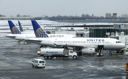 In this Wednesday, March 15, 2017, file photo, United Airlines jets sit on the tarmac at LaGuardia Airport in New York. United Continental Holdings Inc. reports quarterly financial results Monday, April 17, 2017. (AP Photo/Seth Wenig, File)