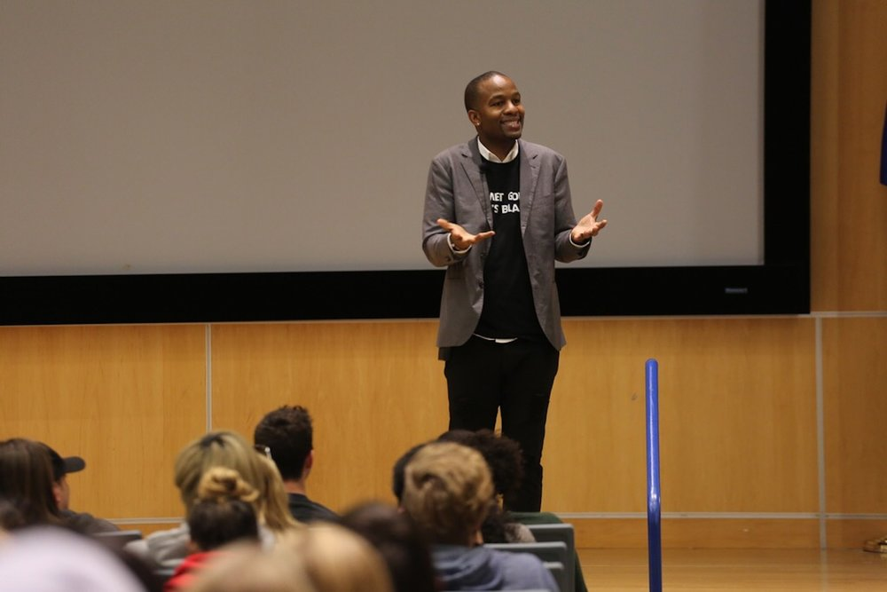Wade Davis addresses UConn students on Tuesday night after becoming the first Diversity and Inclusion consultant for the NFL. (Tyler Benton/The Daily Campus)
