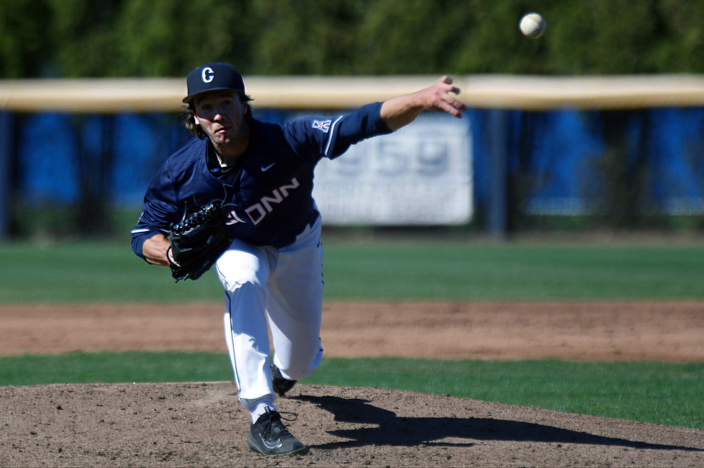 Sophomore P.J. Poulin fires a pitch during the Huskies 11-3 victory over UMass on Tuesday, April 18, 2017. Poulin was an integral part pitching five innings, giving up one run on three hits. (Ian Bethune/The UConn Blog)