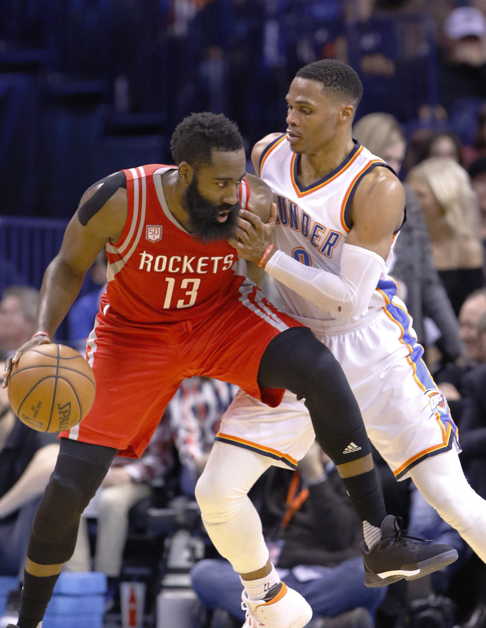 In this Dec. 9, 2016, file photo, Houston Rockets guard James Harden (13) is defended by Oklahoma City Thunder guard Russell Westbrook (0) on a drive to the basket during the second half of an NBA basketball game in Oklahoma City. The playoffs start Saturday, with a series matching MVP candidates Russell Westbrook and James Harden the highlight of the first round. (Alonzo Adams/AP)