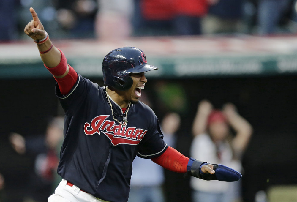 Cleveland Indians' Francisco Lindor celebrates after scoring on a one-run double hit by Michael Brantley in the tenth inning of a baseball game against the Chicago White Sox, Tuesday, April 11, 2017, during opening day in Cleveland. The Indians won 2-1 in 10 innings. (Tony Dejak/ AP)