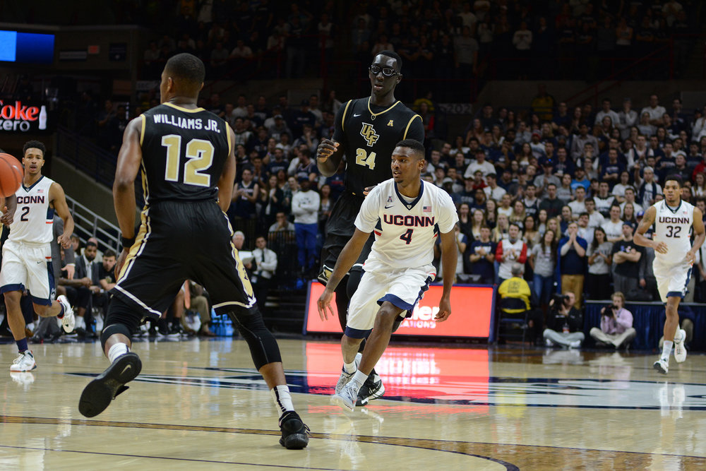 Pictured is Sterling Gibbs vs a UCF opponent.  The Huskies played UCF March 6, 2016 at Gampel Pavillion and won 67-46. (File Photo/ The Daily Campus)
