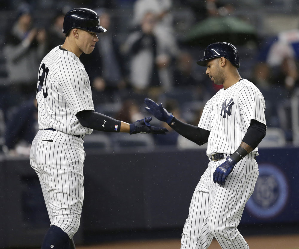 New York Yankees' Aaron Hicks, right, celebrates with Aaron Judge after hitting a solo home run during the eighth inning of the baseball game against the Chicago White Sox at Yankee Stadium, Wednesday, April 19, 2017, in New York. The Yankees defeated the White Sox 9-1. (Seth Wenig/AP)