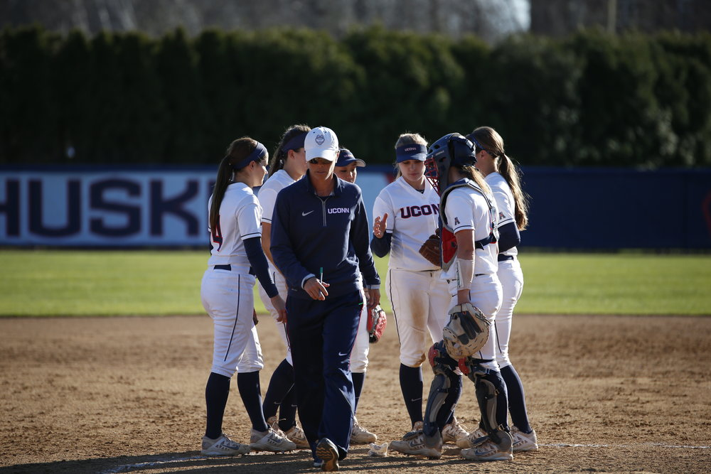 UConn softball head coach Jen McIntyre walks off the field after talking to her team. (Tyler Benton/The Daily Campus)