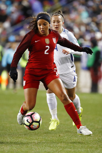 In this Saturday, March 4, 2017, file photo, United States forward Mallory Pugh (2) runs with the ball against England defender Lucy Bronze (4) during the second half of a SheBelieves Cup.Pugh has decided to leave UCLA for a professional soccer career. (AP Photo/Julio Cortez, File)