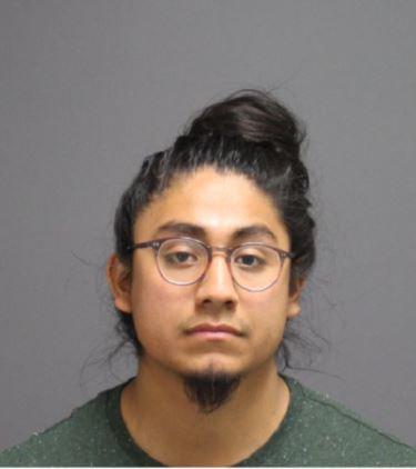 Eric Cruz-Lopez was arrested on May 7th on over 100 accounts of vandalism, with many of the cases including anti-Trump graffiti in the Homer Babbidge Library, the Student Union, the Northwest Dining Hall and other locations around UConn, according to the arrest warrant from the UConn Police Department.(Courtesy/UCPD)